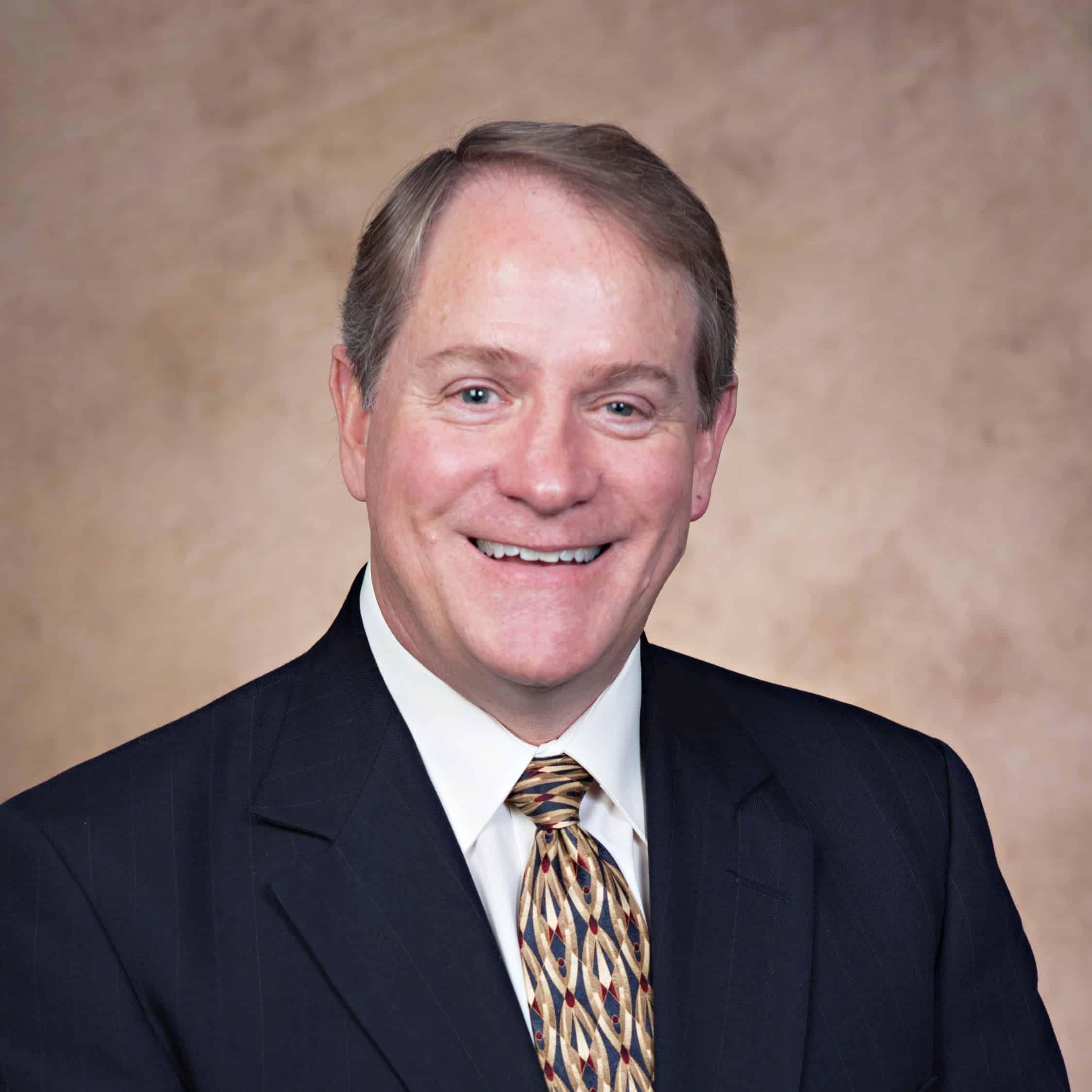 Dr. J.David Arnett